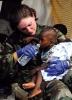 Attualità - Un bambino di Haiti soccorso dopo il terremoto (da internet)