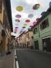 Castano - Gli ombrelli colorati sospesi in Corso San Rocco