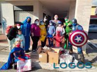 Sociale / Storie - I supereroi durante una consegna